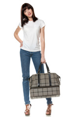Full-body portrait of young female holding her travel bag