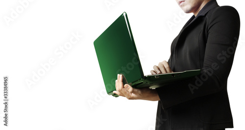 young businessman using laptop in business building
