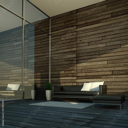 Ledersofa vor Fenster mit Holzwand