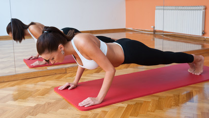 fit woman in push up pose