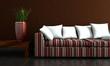 gestreiftes Sofa mit roter Vase