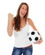 Attraktive jubelnde Frau mit Fußball