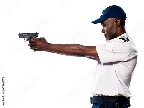 Male police officer aiming gun