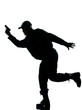 Silhouetted police man running with a handgun