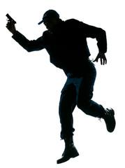 Police officer running with a handgun