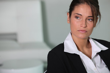 Closeup of a serious young businesswoman