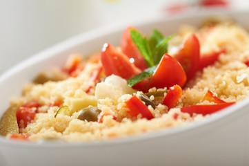 fresh tabule with tomatoes, pepper, cheddar