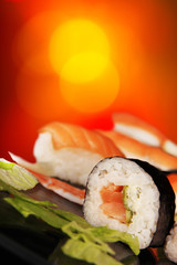 Delicious sushi on shiny blur background