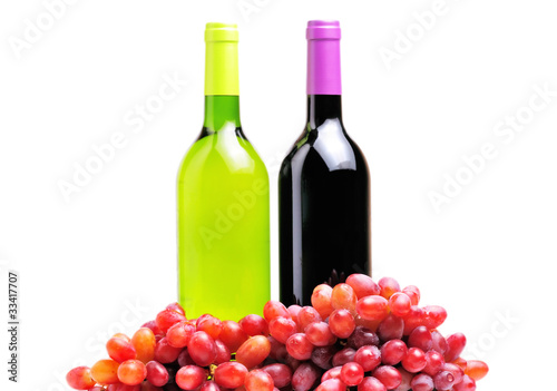 two bottles of wine and the red grape isolated