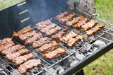 Traditional Croatian cevapcici on the grill