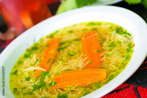Fresh broth with carrot and parsley