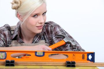 blonde holding a hammer