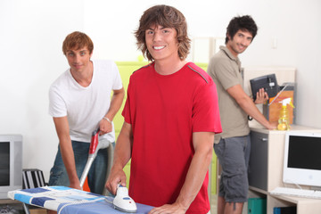 Three young men happy in their housework
