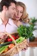 Husband showing wife vegetable basket.