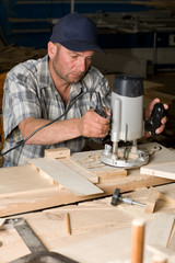Carpenter in the woodworking shop