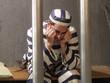 Prisionero en una prisión.