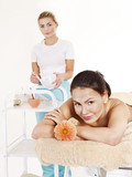 Beautician applying  facial mask by  woman. poster