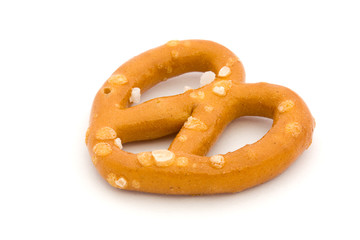 Single salted pretzel on white