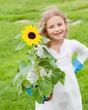 Little gardener with sunflower
