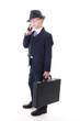 Junger Manager mit Koffer telefoniert