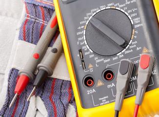 Digital multimeter, probes and gloves