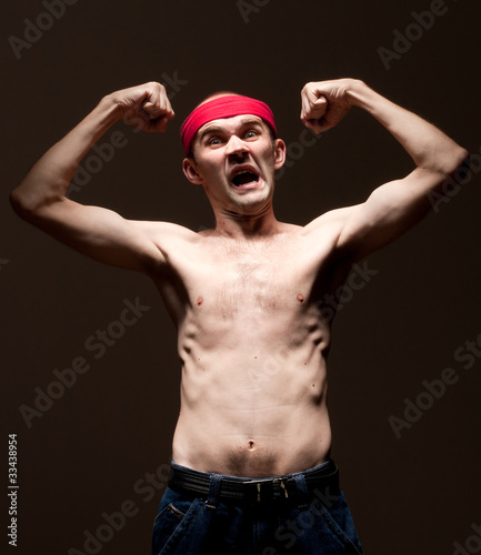 Funny nerd showing his biceps