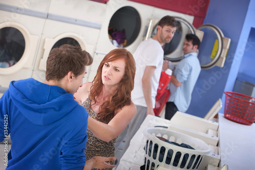 Couple Arguing In Laundromat