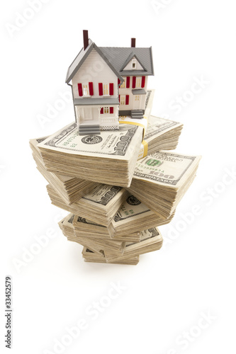 Small House on Stacks of Hundred Dollar Bills