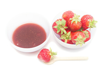Bowl with strawberry jam isolated on white