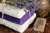Set of natural soap, towels and lavender bouquet