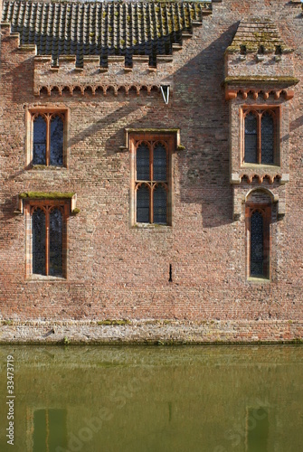 Reflection of the wall in the moat.