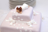 Pink christening cake with little angel on top