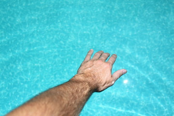 hand reaching into water