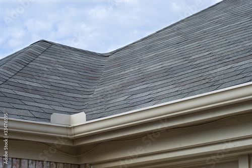Rain Gutters Splash Guard on Roof against blue sky
