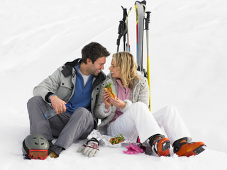 Young Couple With Picnic On Ski Vacation