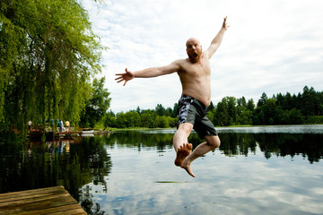 Man jumping in a lake