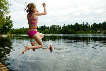 child jumping in a lake