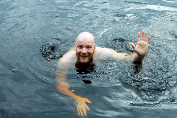 man treading water in a lake