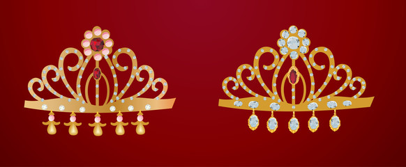 two gold diadems isolated on red