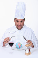 Chef eating planet earth