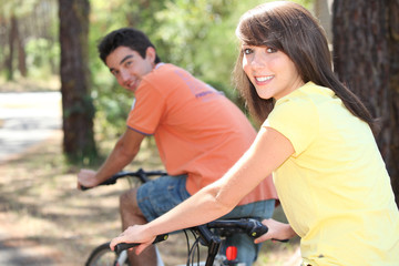 young people biking in the forest