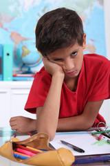 schoolboy visibly bored