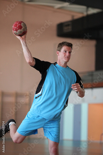 handball player is shooting