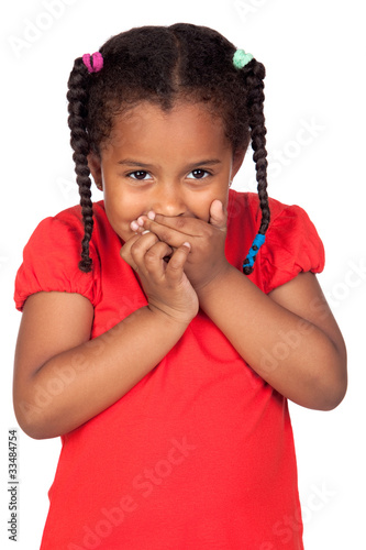 African little girl covering the mouth