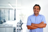 Indian latin businessman blue shirt in modern office