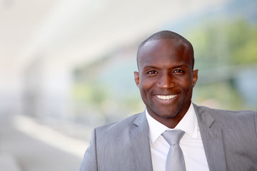 Portrait of handsome businessman wearing grey suit