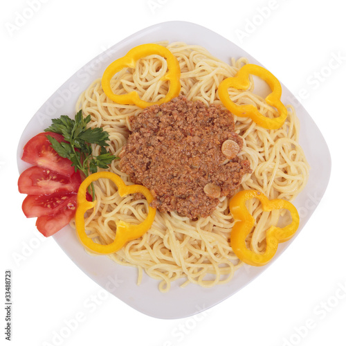 Spaghetti with meat sauce, parsley, tomatoes and peppers on a pl