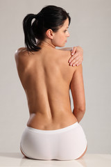 Shoulder back pain for semi naked young woman