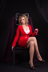 Sexual  lady in red with wine glass in a hand