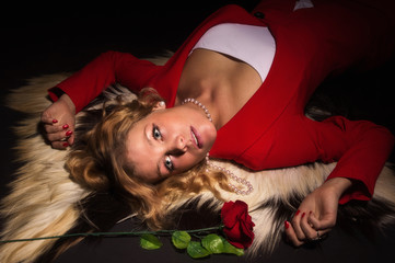 Portrait of sensual lady in red with rose